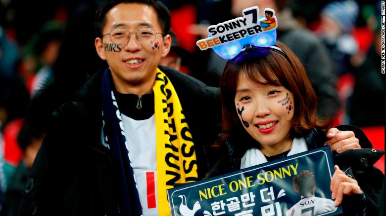 Two fans of Tottenham Hotspur's South Korean striker Son Heung-Min await their hero.