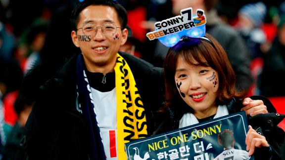 Two fans of Tottenham Hotspur's South Korean striker Son Heung-Min await their hero.