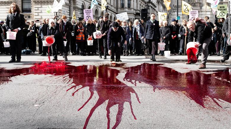 Extinction Rebellion activists threw 200 liters of fake blood outside Downing Street in March 2019.