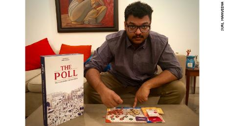 Abeer Kapoor with the board game he invented that was inspired by India's political system.