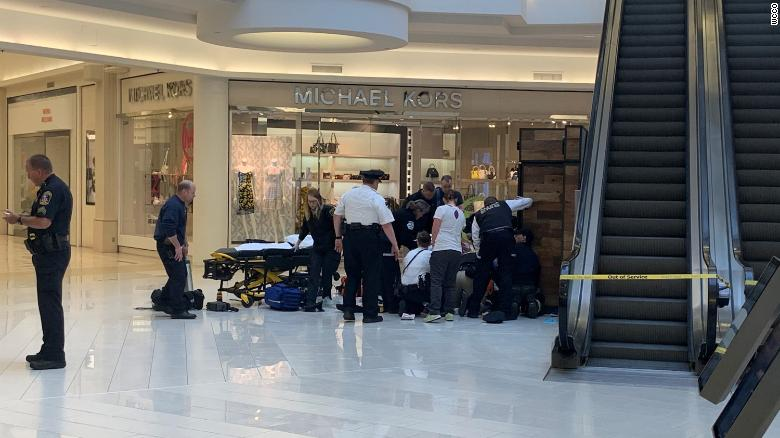 Police and paramedics respond to the scene at the Mall of America on April 12.