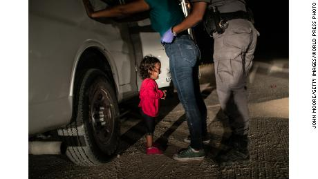 A 2-year-old Honduran girl cries as her mother is searched near the US-Mexico border on June 12. This photo won a World Press Photo prize on Thursday.