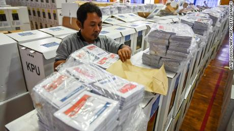 An official prepares ballot boxes and other voting materials in Jakarta ahead of presidential and legislative elections.