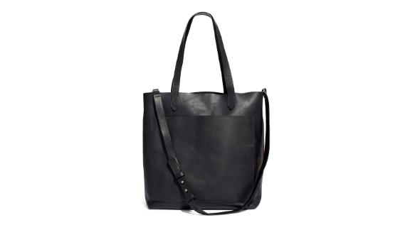 """<strong>Madewell Medium Transport Tote ($158; </strong><a href=""""https://click.linksynergy.com/deeplink?id=Fr/49/7rhGg&mid=1237&u1=0409workbags&murl=https%3A%2F%2Fshop.nordstrom.com%2Fs%2Fmadewell-medium-leather-transport-tote%2F4456231"""" target=""""_blank"""" target=""""_blank""""><strong>nordstrom.com</strong></a><strong>)</strong><br /><br />A classic everyday essential, this fuss-free soft leather tote by Madewell will make your commute and work day a breeze. You can carry it either with its top handles or with its detachable shoulder strap. It has a front pocket for those things you need to find and grab fast.<br />"""