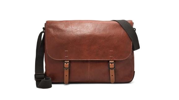 """<strong>Fossil Buckner Messenger ($298; </strong><a href=""""http://www.anrdoezrs.net/links/8314883/type/dlg/sid/0409workbags/https://www.fossil.com/us/en/products/buckner-messenger-sku-MBG9338P.html?gclid=CjwKCAjwhbHlBRAMEiwAoDA342egrcdIc-haVzdi_q9Kf_X5l1tAGDDwJ2AL3I1cvApRVwKOEFnSaRoCEu0QAvD_BwE&ef_id=CjwKCAjwhbHlBRAMEiwAoDA342egrcdIc-haVzdi_q9Kf_X5l1tAGDDwJ2AL3I1cvApRVwKOEFnSaRoCEu0QAvD_BwE:G:s&s_kwcid=AL!4524!3!271287696616!!!g!449491194910!&utm_source=google&utm_medium=cpc&utm_campaign=US%7CFossil%7CPLA%7CProspecting%7CListingAds%7CBags%7CPriorityTerms&utm_content=Top_Selling%7CMens%7CMessanger_Bags"""" target=""""_blank"""" target=""""_blank""""><strong>fossil.com</strong></a><strong>) </strong><br /><br />This definitely qualifies as a grown-up bag. This dapper leather messenger from Fossil means business with its classic look and versatile top handle and shoulder strap.<br />"""