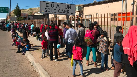 Migrants waited to be fed at a soup kitchen operated by the Kino Border Initiative in Nogales, Sonora. The wait to have an asylum bid heard at the border has soared since January.