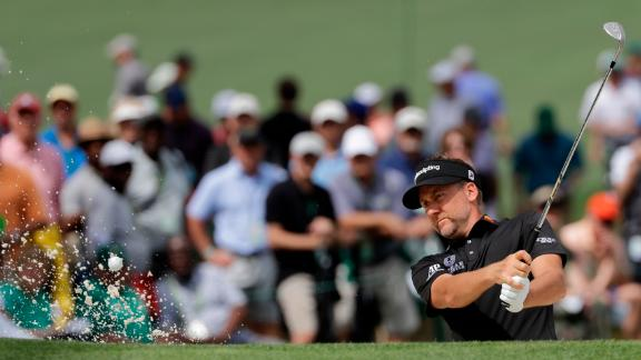 England's Ian Poulter kept up his challenge for a maiden major title with another good round at Augusta.