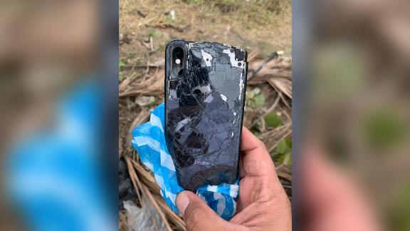 Searchers recover a black iPhone from the waters where the couple went missing.