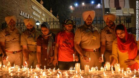 Indian Punjab Police light candles in Amritsar along with local residents to honor the massacre victims.