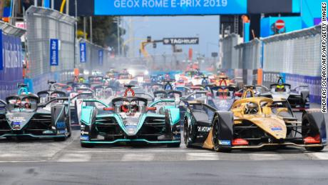 Drivers enter the first turn at the start of the Rome E-Prix.