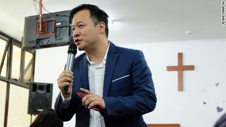 Jonathon Chow, 43, a senior pastor  at the Bread of Life Church, delivers a sermon to the Nairobi congregation during a visit from Taiwan, where he is based and the church is headquartered.