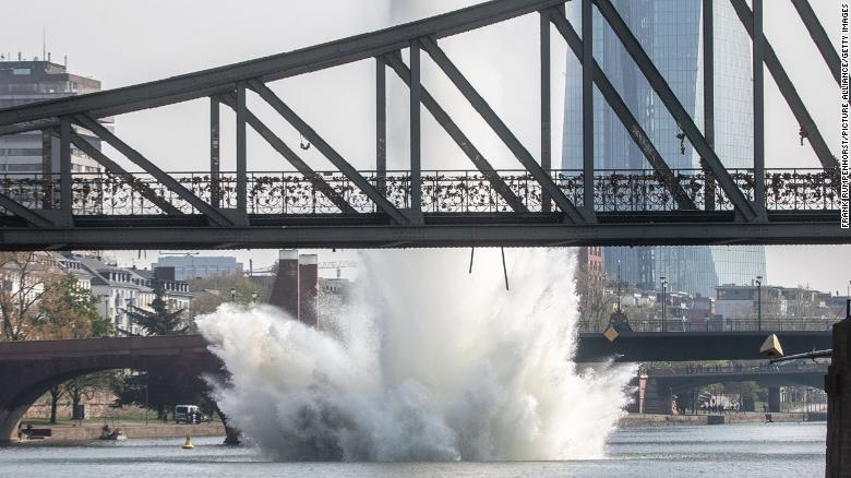 Water shoots out of the Main River as the bomb is detonated.