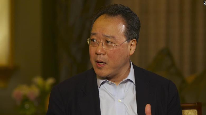 Image result for Cellist Yo-Yo Ma plays a concert at a US-Mexico border crossing to make a point