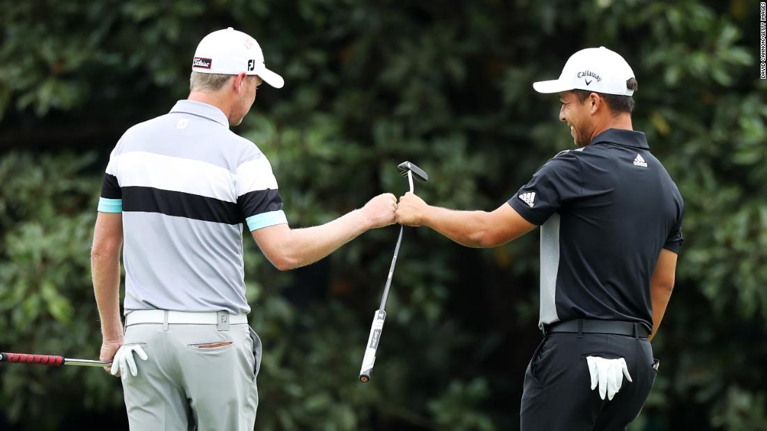 Alongside Woods chasing leader Francesco Molinari were Justin Harding (left) of South Africa and American Xander Schauffele.