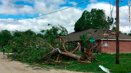 A tree lies on its side following a suspected tornado in Franklin, Texas, on Saturday, April 13, 2019. The storms are part of a large system moving through the southern United States. The weather service said the system is expected to shift to the Ohio Valley and the Southeast on Sunday. (Laura McKenzie/College Station Eagle via AP)