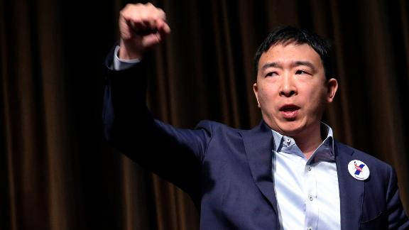 NEW YORK, NY - APRIL 3: Entrepreneur and Democratic presidential candidate Andrew Yang exits the stage after speaking at the National Action Network