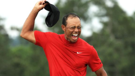 Woods celebrates after sinking the putt that clinched a fifth Masters title -- 14 years after his last.
