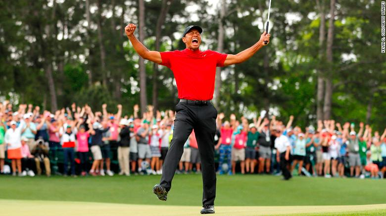 "Woods punched the air to tumultuous applause and chants of ""Tiger, Tiger."""
