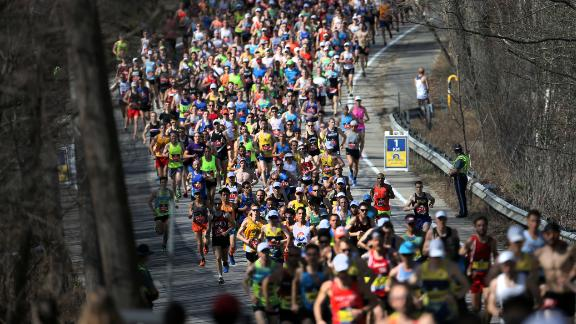 HOPKINTON, MA - APRIL 17: The first wave of runners follows the elite men at the first kilometer mark of the 121st running of the Boston Marathon in Hopkinton, MA on Apr. 17, 2017. (Photo by Lane Turner/The Boston Globe via Getty Images)