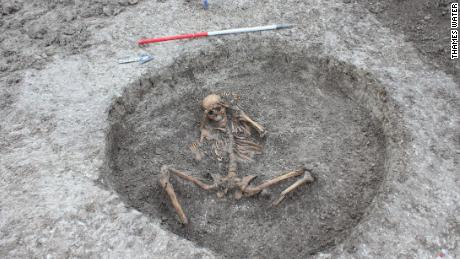 A female skeleton buried with the feet cut off and placed by its side.