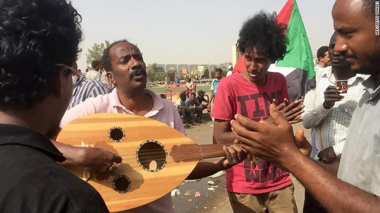 Demonstrators play music in Khartoum.