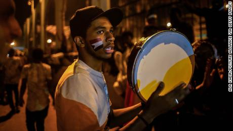 As Bashir faces court, Sudan's protesters keep the music alive