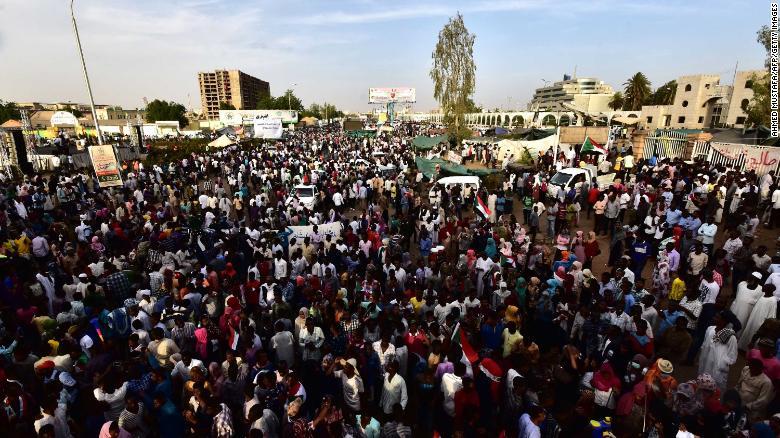 Sudanese demonstrators gather near the military headquarters in the capital Khartoum on April 14, 2019.