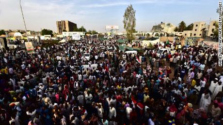 Sudanese demonstrators gather near the military headquarters in the capital Khartoum on April 14, 2019.