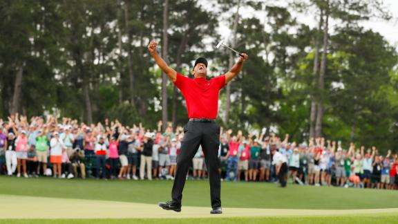 AUGUSTA, GEORGIA - APRIL 14: (Sequence frame 8 of 12) Tiger Woods of the United States celebrates after making his putt on the 18th green to win the Masters at Augusta National Golf Club on April 14, 2019 in Augusta, Georgia. (Photo by Kevin C. Cox/Getty Images)