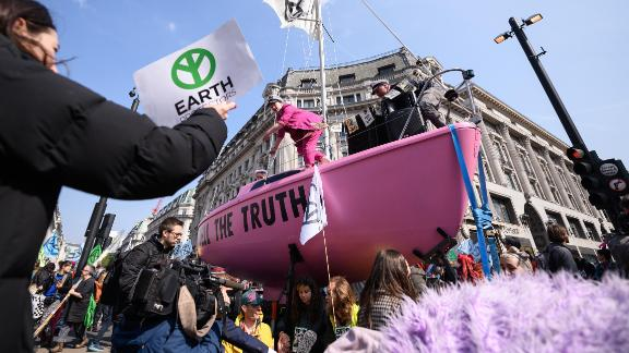 "A pink sailboat with the message ""TELL THE TRUTH"" blocks Oxford Circus."