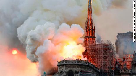 Smoke and flames rise during a fire at the landmark Notre-Dame Cathedral in central Paris on April 15, 2019, potentially involving renovation works being carried out at the site, the fire service said. - A major fire broke out at the landmark Notre-Dame Cathedral in central Paris sending flames and huge clouds of grey smoke billowing into the sky, the fire service said. The flames and smoke plumed from the spire and roof of the gothic cathedral, visited by millions of people a year, where renovations are currently underway.