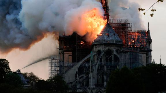 Flames and smoke are seen billowing from the roof at Notre Dame Cathedral in Paris