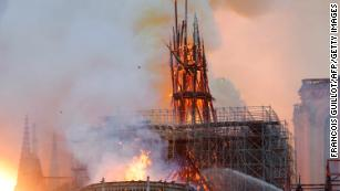 See moment Notre Dame's spire falls