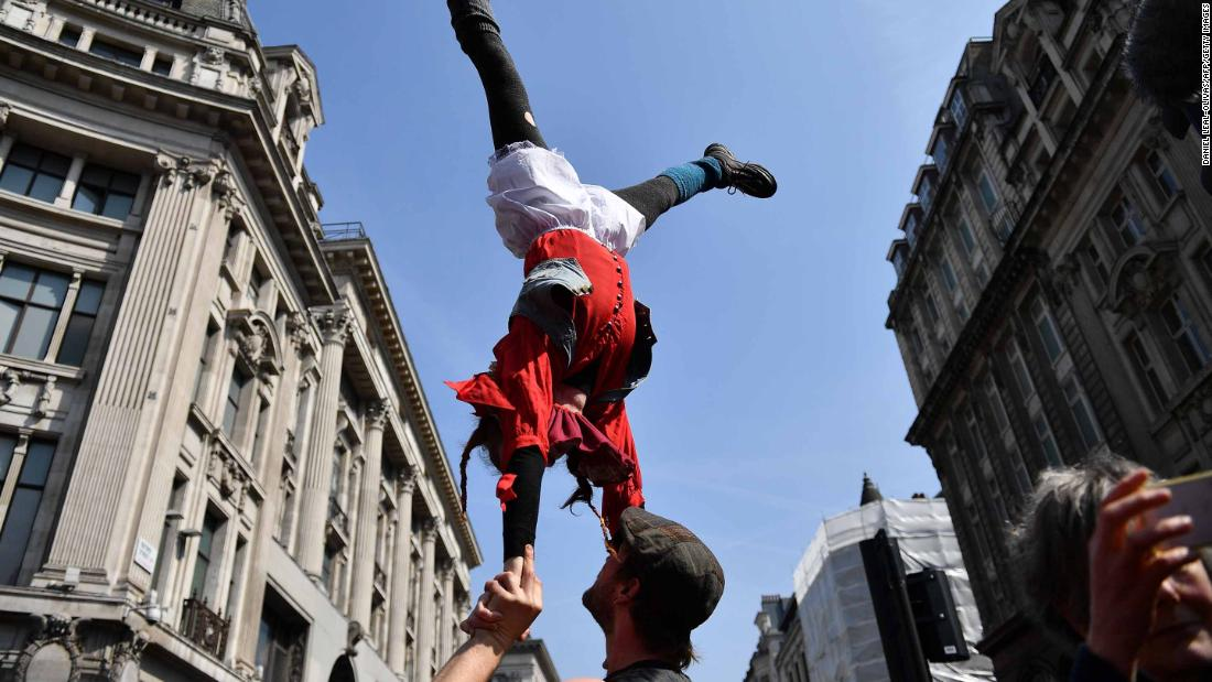 Acrobats participate in the demonstration at Oxford Circus on April 15.