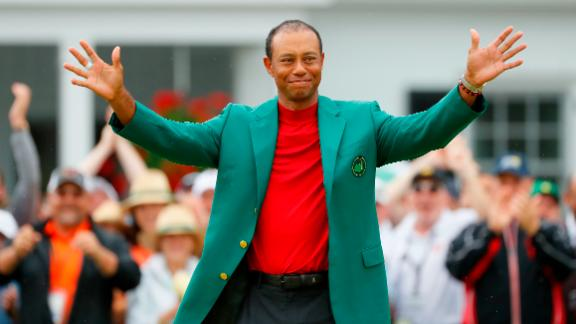 AUGUSTA, GEORGIA - APRIL 14: Tiger Woods of the United States smiles after being awarded the Green Jacket during the Green Jacket Ceremony after winning the Masters at Augusta National Golf Club on April 14, 2019 in Augusta, Georgia. (Photo by Kevin C. Cox/Getty Images)