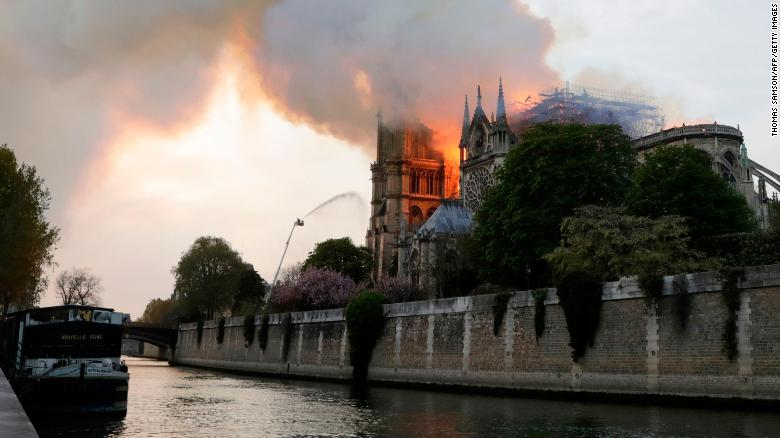 Flames and smoke are seen billowing from the roof of the Notre Dame.