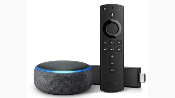 """<a href=""""https://amzn.to/2Db00rd"""" target=""""_blank"""" target=""""_blank""""><strong>Fire TV Stick 4K with Echo Dot ($79.98, originally $99.98; amazon.com)</strong></a>"""