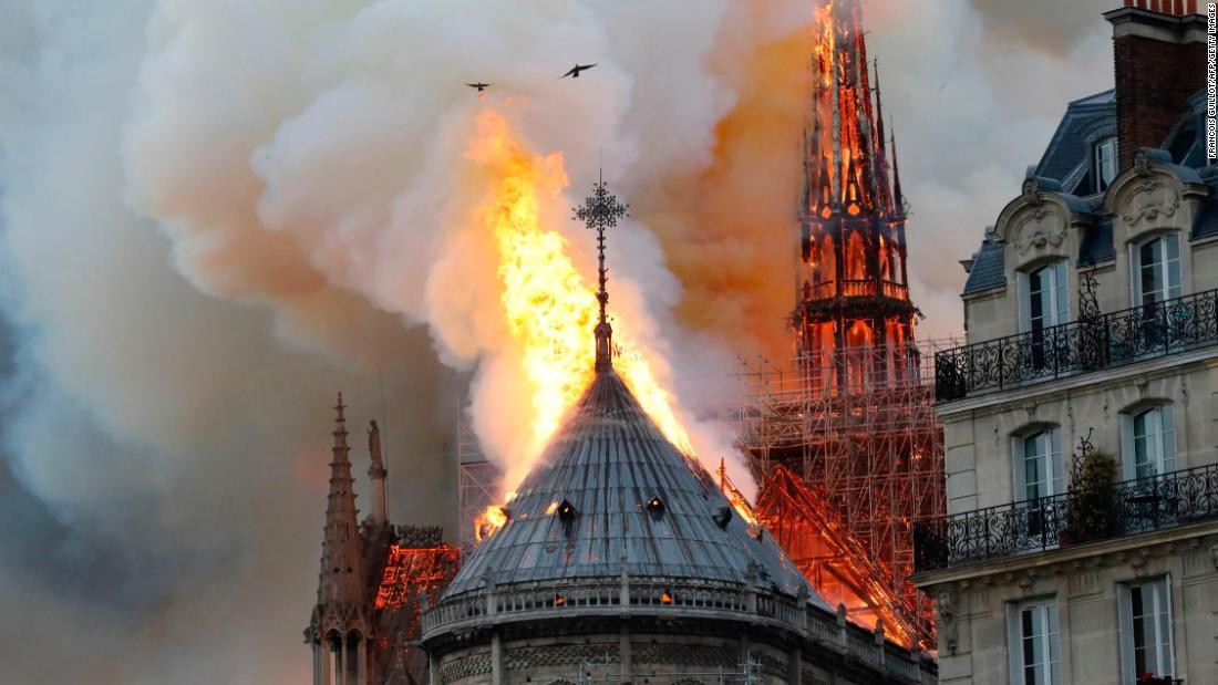 Smoke and flames rise during a fire at the Notre Dame cathedral in Paris on Monday, April 15.