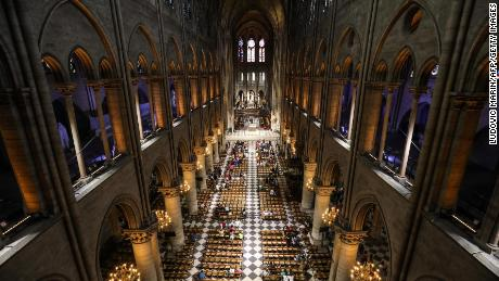 TOPSHOT - This photograph taken on June 26, 2018, shows worshippers as they arrive to take part in a mass at Notre Dame de Paris Cathedral in Paris. (Photo by Ludovic MARIN / AFP)        (Photo credit should read LUDOVIC MARIN/AFP/Getty Images)
