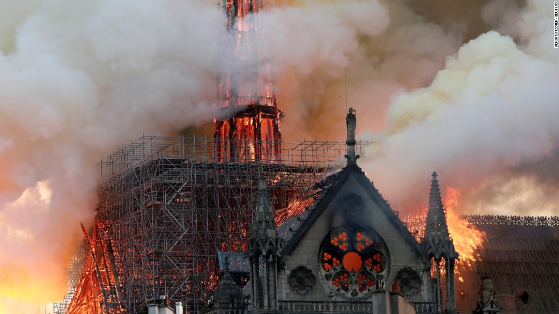 Smoke billows as fire engulfs the spire of Notre Dame Cathedral in Paris on Monday, April 15. The massive blaze devastated large areas of the iconic 850-year-old cathedral, but many priceless artifacts and relics were rescued.