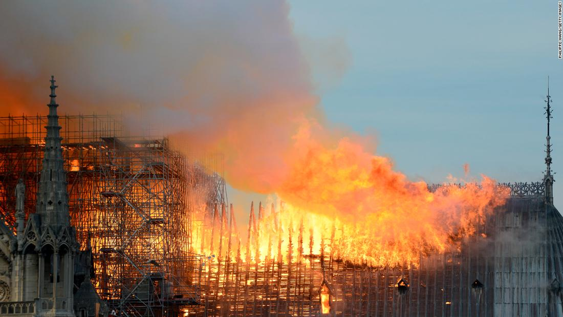 Flames roar across the roof of the cathedral.