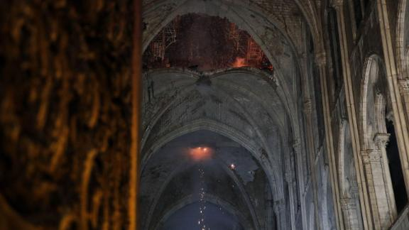 The smoldering roof of the cathedral overnight.