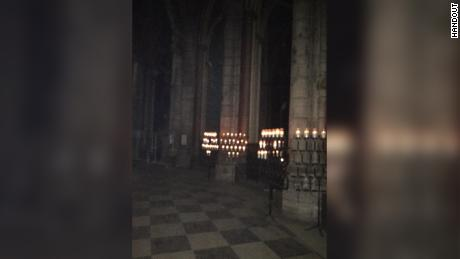 Candles still burning inside the cathedral, in this photo obtained by CNN.