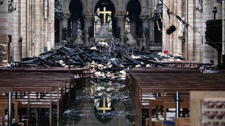 Debris from the roof lies near the altar inside Notre Dame Cathedral in Paris on Tuesday, April 16.