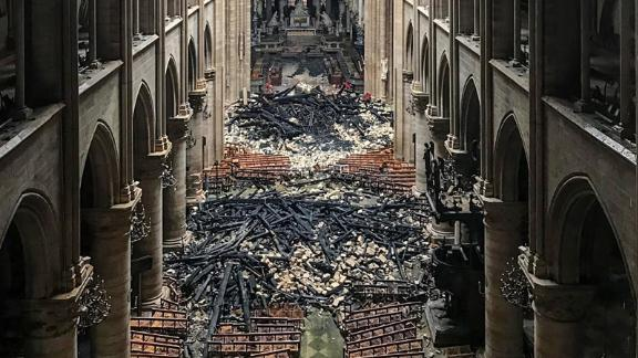 A picture taken on April 16, 2019 shows an interior view of the Notre-Dame Cathedral in Paris in the aftermath of a fire that devastated the cathedral. - The Paris fire service announced that the last remnants of the blaze were extinguished on April 16, 15 hours after the fire broke out. Thousands of Parisians and tourists watched in horror from nearby streets on April 15 as flames engulfed the building and rescuers tried to save as much as they could of the cathedral's treasures built up over centuries. (Photo by - / AFP)        (Photo credit should read -/AFP/Getty Images)
