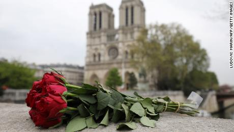 Roses have been laid near Notre-Dame-de Paris Cathedral a day after a fire devastated the cathedral in central Paris on April 16, 2019.
