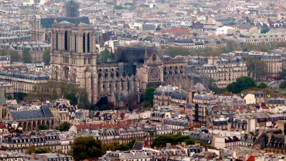 The burnt out cathedral is seen from the top of the Montparnasse tower the day after the fire.