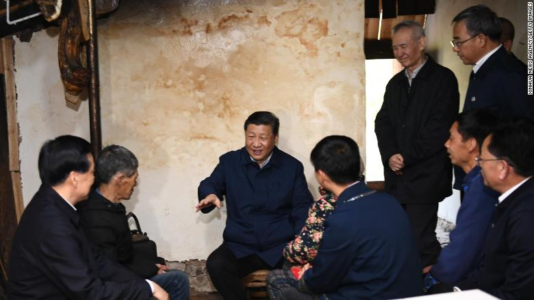Chinese President Xi Jinping visits a villager's home to learn about the progress of poverty alleviation in Huaxi village on April 15.