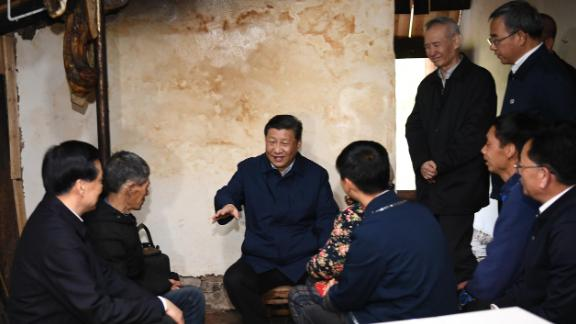 Chinese President Xi Jinping visits a villager