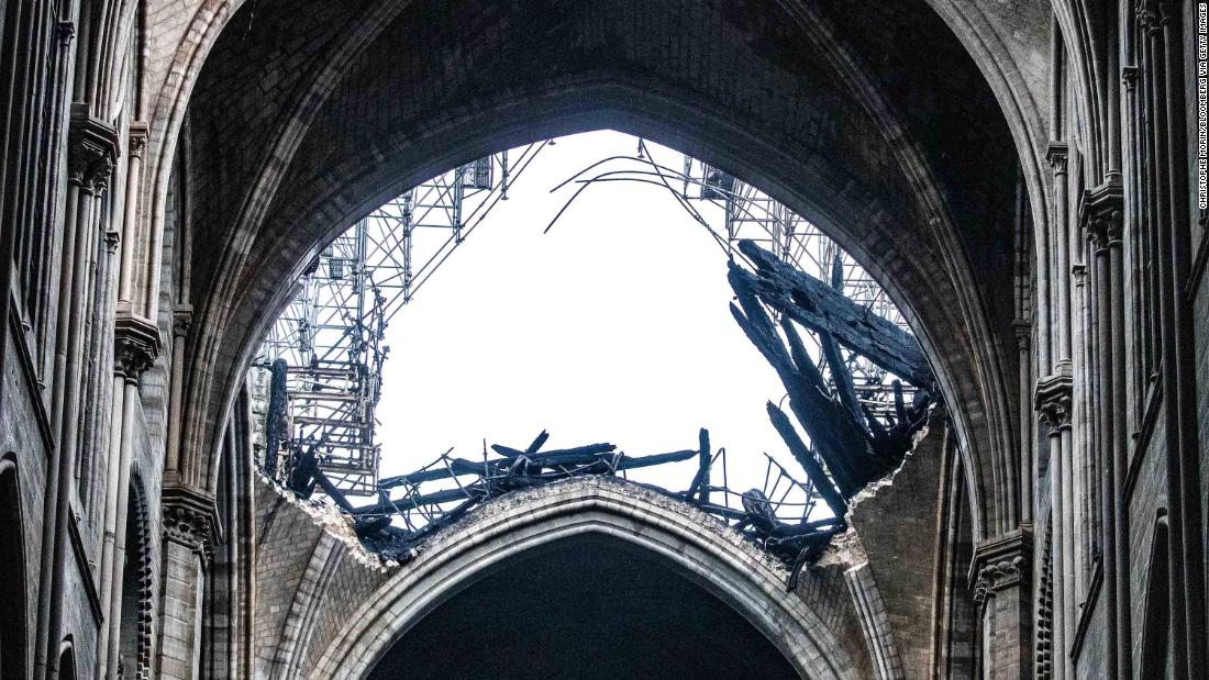 Daylight shines through the fallen roof of Notre Dame on April 16.
